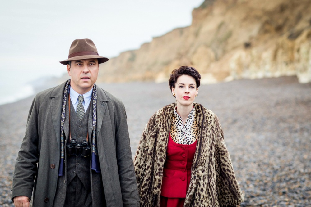 Programme Name: Partners In Crime - TX: 23/08/2015 - Episode: 5 (No. 5) - Picture Shows: Episode Five: 'N or M?' Tommy Beresford (DAVID WALLIAMS), Tuppence Beresford (JESSICA RAINE) - (C) Endor Productions - Photographer: Laurence Cendrowicz