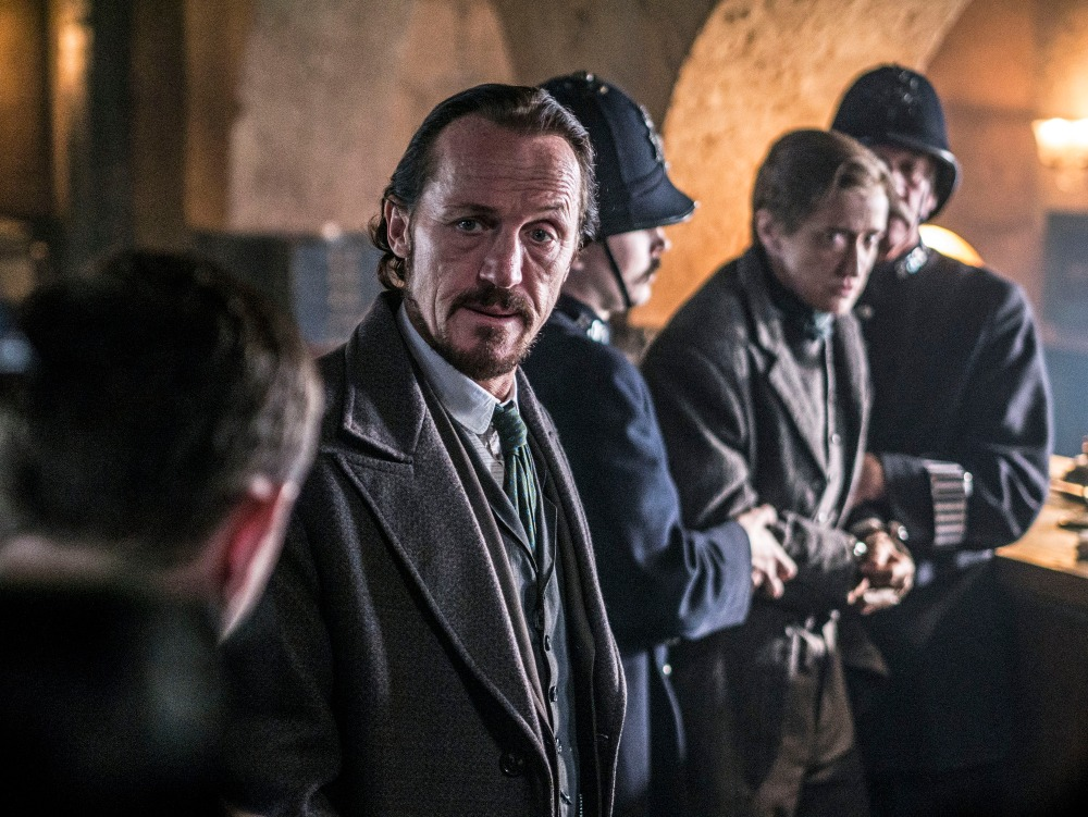 Programme Name: Ripper Street - TX: n/a - Episode: n/a (No. 7) - Picture Shows:  Detective Sergeant Bennet Drake (JEROME FLYNN), George Tait (HAYDN GWYNNE), Supporting Artists - (C) Tiger Aspect 2014 - Photographer: Bernard Walsh