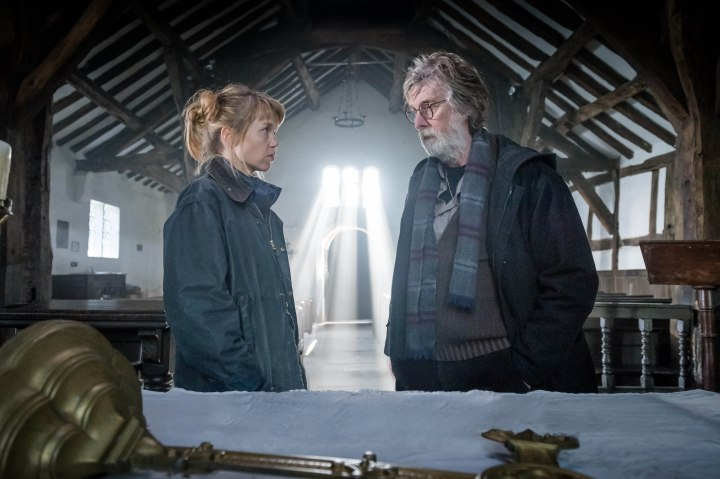 From ITV Studios Midwinter Of The Spirit: Ep1 on ITV Pictured: Rev. Merrily Watkins [Anna Maxwell Martin] and Rev. Huw Owens [David Threlfall]. Merrily is deeply human in her doubts and scepticism, but her knowledge of the paranormal underworld brings her to the notice of local police who need her advice in the investigation of a grisly murder. This photograph is (C) ITV Plc and can only be reproduced for editorial purposes directly in connection with the programme or event mentioned above, or ITV plc. Once made available by ITV plc Picture Desk, this photograph can be reproduced once only up until the transmission [TX] date and no reproduction fee will be charged. Any subsequent usage may incur a fee. This photograph must not be manipulated [excluding basic cropping] in a manner which alters the visual appearance of the person photographed deemed detrimental or inappropriate by ITV plc Picture Desk. This photograph must not be syndicated to any other company, publication or website, or permanently archived, without the express written permission of ITV Plc Picture Desk. Full Terms and conditions are available on the website www.itvpictures.com For further information please contact: james.hilder@itv.com / 0207 157 3052